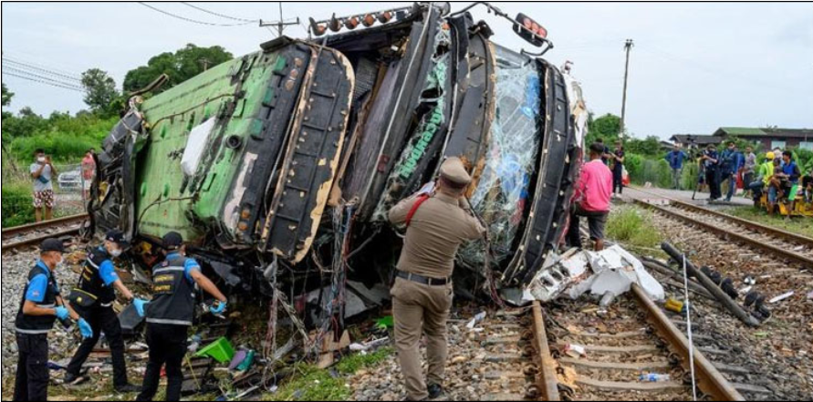 In Thailand, a passenger bus collided with a train, killing 20 people and injuring 29