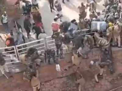 Farmers Rally In Delhi - Cops Jump Off Wall To Escape Protestors At Red Fort