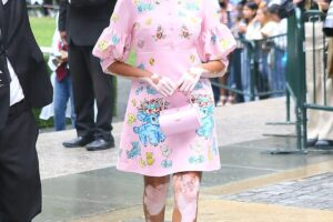 Winnie Harlow stuns in cute cartoon print dress as she walks for Moschino at NYFW
